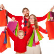 Father, mother and child holding up shopping bags — Stock Photo