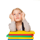 Little bored student girl with books. — Stock Photo