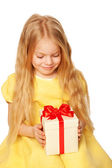 Pretty little girl enjoying gift. Festive concept. — Стоковое фото