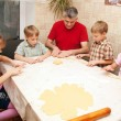 Stock Photo: Father and four children in the kitchen.