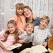 Stock Photo: Four children hugging mother. Family concept.