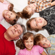 Stock Photo: Father, mother and four children smiling.