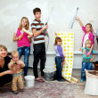 Big family making repairs to their new home. — Stock Photo