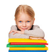Student and books. Little girl in the classroom. — Stock Photo