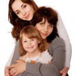 Happy mother and two daughters, teenager and toddler. — Stock Photo #22439217