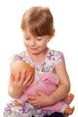 Little girl hugging a doll. Nursing concept. — Stock Photo
