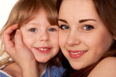 Two sisters, teenager and little girl. Face closeup. — Stock Photo