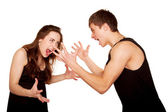 Teenagers boy and girl quarreling, gesticulating and shouting — Stock Photo