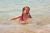 Little girl swimming in the sea. Summer holidays. — Stockfoto