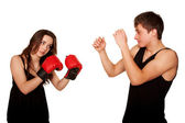 The girl beating the guy, the guy defending himself. — Stock Photo