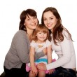 Happy smiling family, mother and two daughters — Stock Photo #26024807