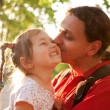 Father kissing daughter. Happy family. — Stock Photo #26157213