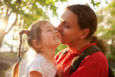 Father kissing daughter. Happy family. — Stock Photo