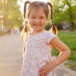 Little smiling girl in the sunlight. — Stock Photo