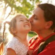 Father kissing daughter. Happy family — Stock Photo