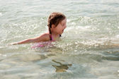 Little girl swimming in the sea. — Stock Photo
