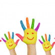 Children's smiling colorful hands raised up. — Stock Photo
