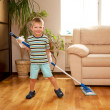 Stock Photo: Little boy cleaning the apartment, washing the floor