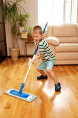 Little boy cleaning apartment. Little home helper. — Stock Photo