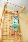 Little child playing sports at sport center. — Stock Photo