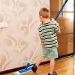 Little boy cleaning apartment, washing floor — Stock Photo #26932901