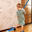 Stock Photo: Little boy cleaning apartment, washing floor