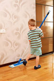 Little boy cleaning apartment, washing floor — Stock Photo