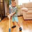 Little boy cleaning room. Mother's helper. — Stock Photo