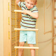 Little child climbing on rope ladder. — Stock Photo