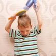 Little boy drying hair with hair dryer. — Stock Photo #27131043