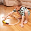 Little boy playing with wooden railway — Stock Photo
