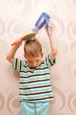 Little boy drying hair with hair dryer. — Stock Photo
