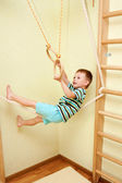 Little child walking on tightrope in the sports complex. — Stock Photo