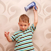 Little boy drying hair with the hair dryer. — Stock Photo