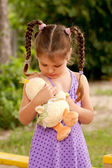 Little girl taking care of toy. — Stock Photo