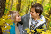Loving young couple in the autumn forest — Stock Photo