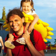 Father and daughter. Baby sitting on daddy's shoulders  — Stock Photo