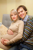 Beautiful pregnant couple in love — Stock Photo