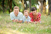 Happy family outdoors. Summer holiday. — Stock Photo