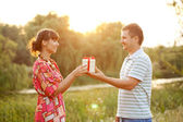 Middle-aged couple in love in the sunlight — Stock Photo