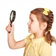 Little girl looking through a magnifying glass — Stock Photo #28603433