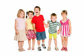 Group of little children holding hands and smiling. — Stock Photo