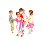 Group of little children dancing, holding hands — Stock Photo