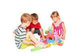 Three children playing and building together. — Stock Photo