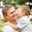 Happy father and son outdoors — Stock Photo #28932597