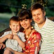 Happy family outdoors. Father, mother and son — Stock Photo