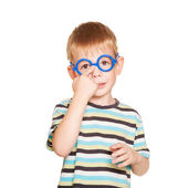 Little boy adjusting his glasses. Isolated on white — Stock Photo