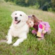 Happy child and a dog breed golden retrieve — Stock Photo