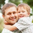 Happy father and son outdoors. — Stock Photo