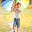 Adorable boy with colorful umbrella — Stock Photo